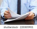 auditor is reading documentation | Shutterstock . vector #220305901