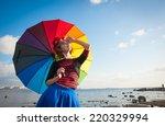 portrait of a woman in a clown...   Shutterstock . vector #220329994