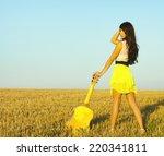 pretty girl posing in a field... | Shutterstock . vector #220341811