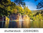Stock photo majestic view on waterfall with turquoise water and sunny beams in the plitvice lakes national park 220342801