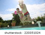 kids jumping in swimming pool | Shutterstock . vector #220351024