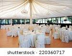 wedding venue under a marquee... | Shutterstock . vector #220360717