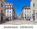 Small photo of Lisbon, Portugal. August 31, 2014: Augusta Street in the Downtown District, known as Baixa. Considered as the most cosmopolitan street of the capital, is permanently filled with Lisboans and tourists