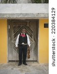 Small photo of Senior Mariachi violinist standing in a doorway