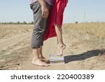 a girl stands on a stack of... | Shutterstock . vector #220400389