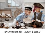two boys  a pirate captain ... | Shutterstock . vector #220411069