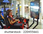a young boy playing video games | Shutterstock . vector #220455661