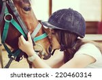 Stock photo happy young people on countryside with horse for riding 220460314