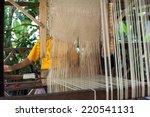 Woman Weaving Silk In...