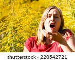 Young Woman Sneezing Because O...