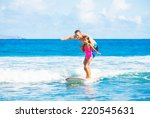 Father And Daughter Surfing...