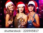 Three Cheerful Girls In Santa...