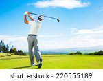 Man Playing Golf On Beautiful...