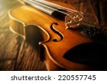 Violin in vintage style on wood ...