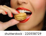 close up to macaroon on hand  ... | Shutterstock . vector #220558729