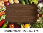 vegetables on old wooden... | Shutterstock . vector #220563175