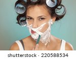 attractive young woman shaves... | Shutterstock . vector #220588534