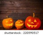 pumpkins on wooden background... | Shutterstock . vector #220590517