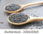 black sesame on wooden spoon.   Shutterstock . vector #220610365