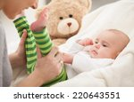 mother playing with her 3... | Shutterstock . vector #220643551