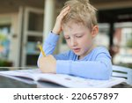concentrated little boy doing... | Shutterstock . vector #220657897