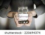 senior woman holding retirement ... | Shutterstock . vector #220694374