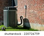 Air conditioner with cat walking by - stock photo