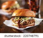 two pulled pork bbq sandwiches... | Shutterstock . vector #220748791