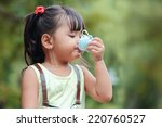 little asian girl drinking... | Shutterstock . vector #220760527