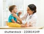 doctor examining little boy... | Shutterstock . vector #220814149