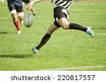 Rugby Player Legs Kicking The...