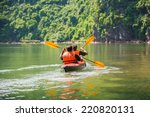 two men paddle a kayak on the... | Shutterstock . vector #220820131