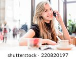 woman using mobile phone in a... | Shutterstock . vector #220820197