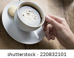 cup of coffee being stirred by... | Shutterstock . vector #220832101