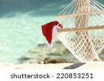 hammock on a tropical beach... | Shutterstock . vector #220853251
