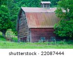 Old Red Wooden Barn Among Gree...