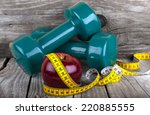 measuring tape wrapped around a ... | Shutterstock . vector #220885555