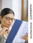 indian businesswoman reading... | Shutterstock . vector #220908994