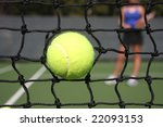 high impacting tennis ball in net on powerful ace serve - stock photo