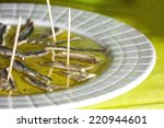 marinated anchovies in olive oil | Shutterstock . vector #220944601