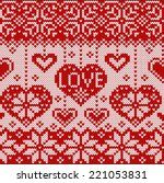 knitted pattern with hearts.... | Shutterstock .eps vector #221053831