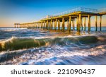 A Fishing Pier And Waves In Th...