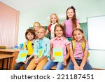 schoolchildren sitting close... | Shutterstock . vector #221187451