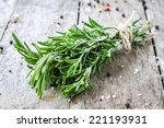 a bunch of fresh rosemary on a... | Shutterstock . vector #221193931