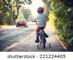 boy on bike on sidewalk   Shutterstock . vector #221224405