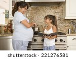 pregnant hispanic mother and... | Shutterstock . vector #221276581