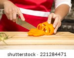 caucasian woman about to cut... | Shutterstock . vector #221284471
