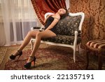 sexual woman in a black... | Shutterstock . vector #221357191