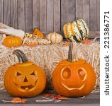 two carved pumpkins on a rustic ... | Shutterstock . vector #221386771