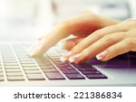 female hands on laptop  close up | Shutterstock . vector #221386834